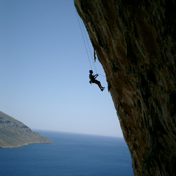Climbing up a cliff. Hang in there! Photo by Maira Kouvara via stock.xchng.